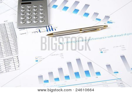 Calculator, pen and business charts, concept