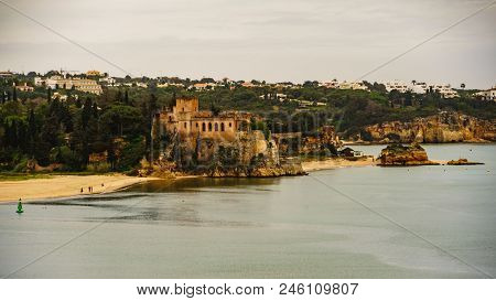 The Traditional Village And Castle Of Portimao In Algarve, Portugal.  View From The Portimao Harbor.