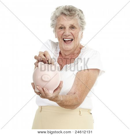 portrait of senior woman saving coin in piggy bank over white