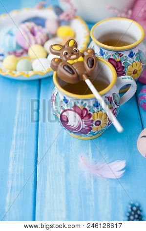 Easter Sweets For The Holiday. Spring. Bright Colors On Coffee Mugs. Chocolate Bunny. View From Abov