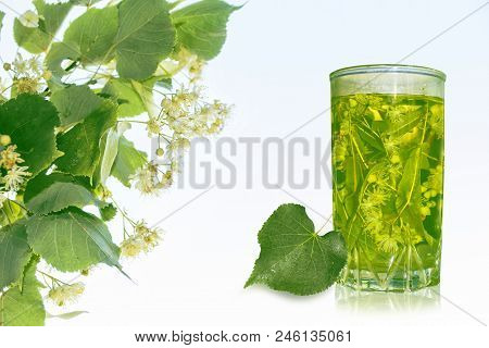 Lime Glass Of Hot Tea. Floral Background.