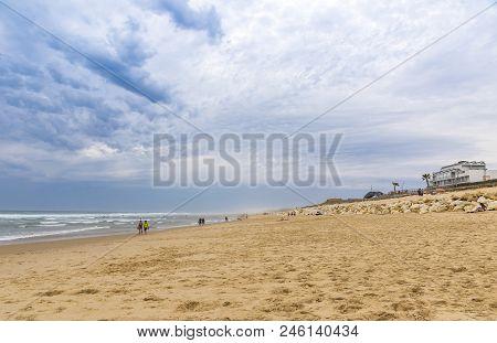 People Enjoying The Windy Summer Day At The Beach On The Atlantic Coast Of France Near Lacanau-ocean