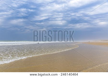 Ocean Beach On The Atlantic Coast Of France Near Lacanau-ocean, Bordeaux, France. Windy And Cloudy S