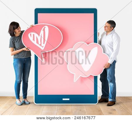 Couple dating online holding heart icons