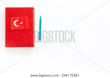 Language Study Concept. Textbooks Or Dictionaries Of Foreign Language Near Turkish Flag On White Bac