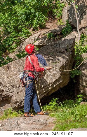 Rock Climbing. Insurance Climber Near The Rock. Professional Equipment For Mountaineering. Rope