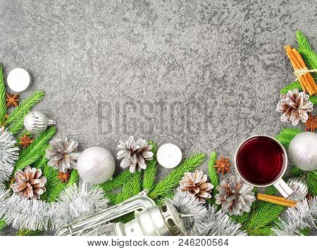 Christmas And Happy New Year Background With Tea. Top View, Copy Space, Military Stile. Fir Branches