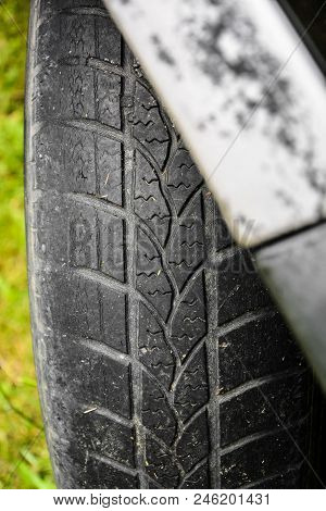 Damaged Black Tire Of A Large Car. Old Tires, Detail Of Old And Worn Wheels, Wheels To Pull. Deflate