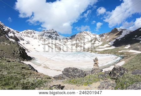 Large-format Picture With The Effect Of Panorama, Ice Lake Against The Background Of Snow-capped Mou