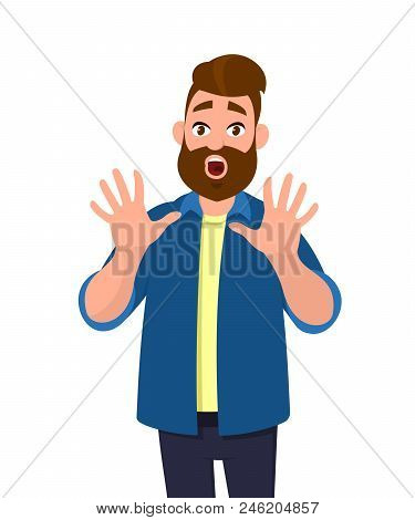 Man With Scared Expression On His Face Making Frightened Gesture With His Palms As If Trying To Defe