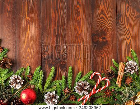 Christmas And Happy New Year Dark Brown Background. Top View, Copy Space, A Wooden Rustic Table, Fir