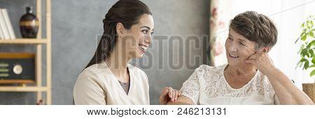 Happy Volunteer And Elderly Woman