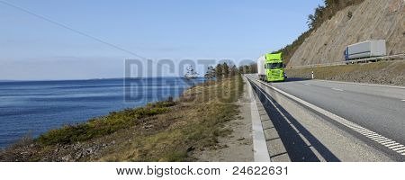 truck transports, driving on scenic route of highway, panoramic view.