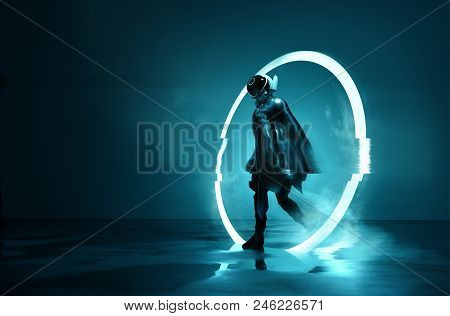 Exiting The Void. A Futuristic Space Astronaut Exiting A Glowing Loop Through Time. Conceptual 3d Il