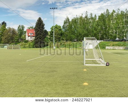 Synthetic grass for football (soccer) sport field. Pattern of green artificial turf. Outdoor training play field poster