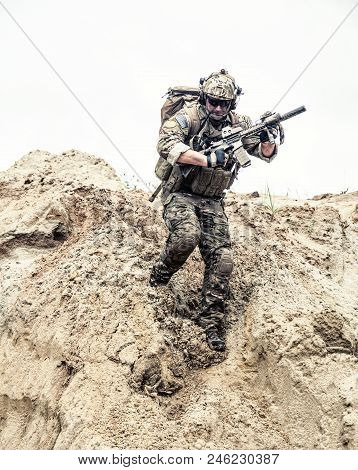 United States Army Commando, Special Forces Infantry Armed With Assault Rifle In Combat Uniform And