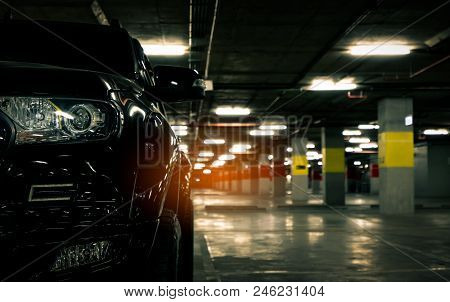 Front View Of Black Car Parked At Underground Car Parking Of Shopping Mall. Parking Lot Of Shopping