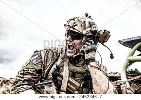 Special Forces Soldier, Military Communications Operator Or Maintainer In Helmet And Glasses, Scream