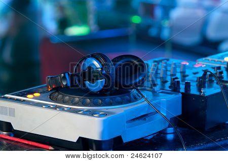 Dj Mixer With Headphones At A Nightclub