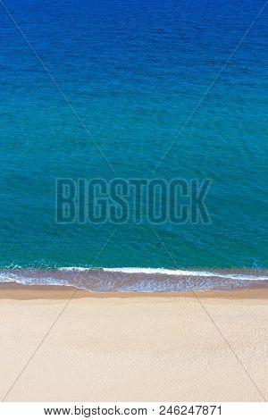Summer Background - Aerial View Of Blue Sea And Yellow Sand