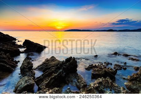 Sunset And Beach With Rocks In The Evening,at Aonang Krabi,thailand.