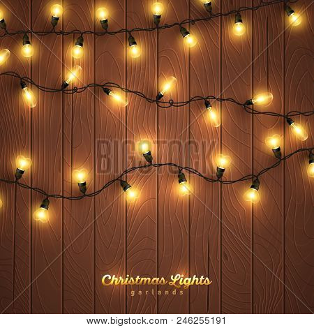 Yellow Christmas Lights On Wooden Background. Vector Illustration. Glowing Bulbs For Xmas And New Ye