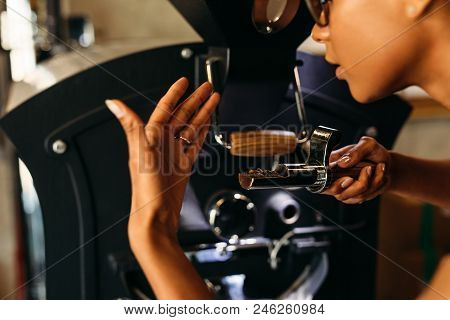Close Up Shot Of Barista Smelling A Fresh Roasted Coffee