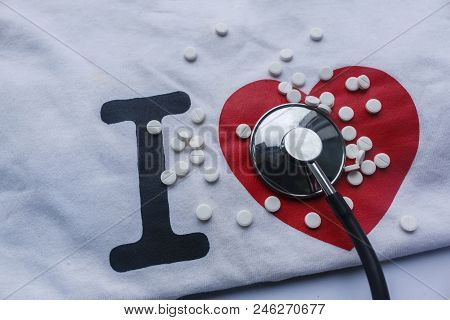 Conceptual Photo That Depicts The Process Of Treating The Heart. Large Black I Letter With A Red Hea