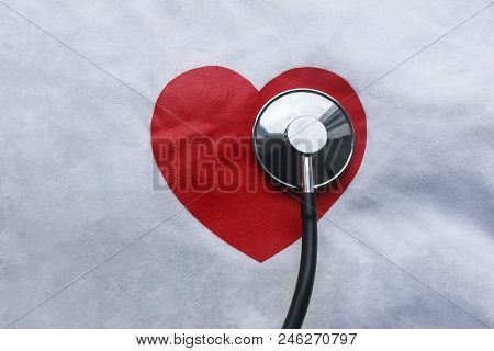 Medic Stethoscope And Red Heart Drawn On Canvas With Copy Space