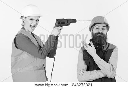 Husband Annoyed By Wife. Builder Makes Hole In Male Head. Carefree And Relaxed Concept. Woman Drills