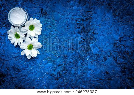 Hypoallergenic Baby Cream. Chamomile Cream In Small Jar Near Chamomile Flowers On Blue Background To