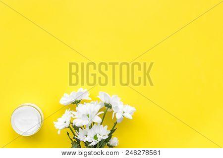 Moisturizing Cream Based Of Natural Herbal Ingredients. Chamomile Cream In Small Jar Near Chamomile