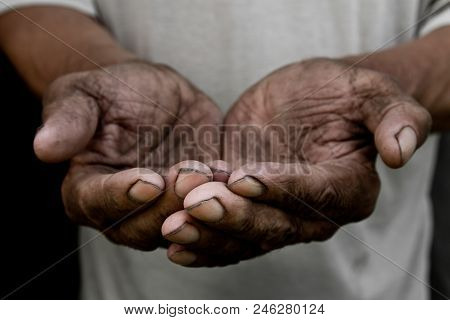 The Poor Old Man's Hands Beg You For Help. The Concept Of Hunger Or Poverty. Selective Focus. Povert