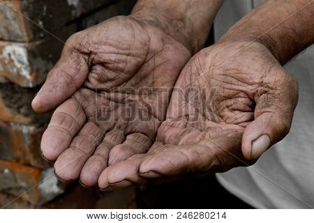 Hands Poor Poverty Elder Man Begging You For Help. Concept Hunger People Or Poverty. Selective Focus