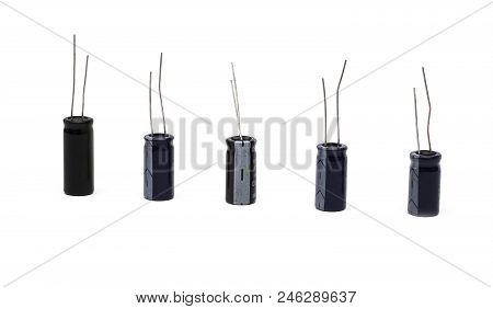 Five Black Electrolytic Capacitors On A White Background, Isolate, Electronic