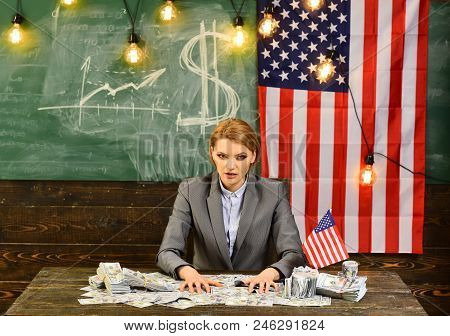 Economy And Finance. Economy Of America With Woman Holding Money At Flag