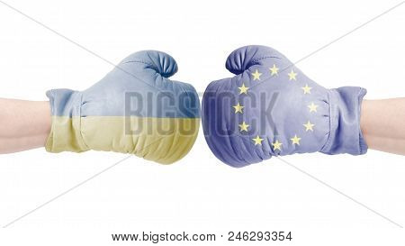Boxing Gloves With European Union And Ukraine Flag.european Union Vs Ukraine Concept.isolated On A W