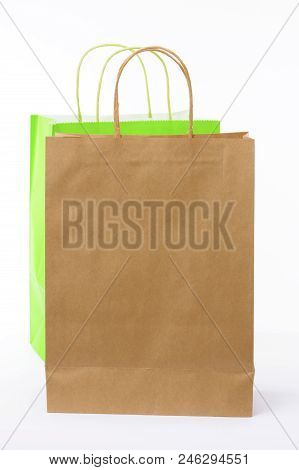 Brown And Green Paper Shopping Bags On White Background. Empty Area.