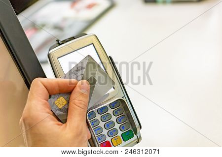 Male Paying With Nfc Technology On Credit Card, Hands Close Up. Man Using Credit Card For Pay By The
