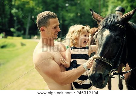 Equine therapy, recreation concept. Friend, companion, friendship. Girl with man pet horse on sunny day. Child with muscular macho smile to animal. Equine therapy, recreation concept. Happy childhood, fathers day. poster