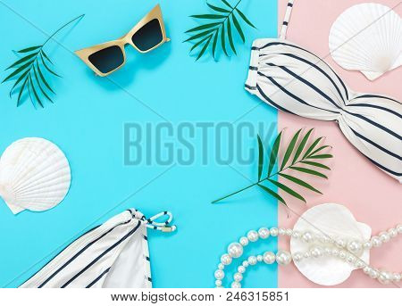 Tropical Summer Vacation Flat Lay On Blue And Pink Background, With Copy Space. Bikini, Sunglasses,