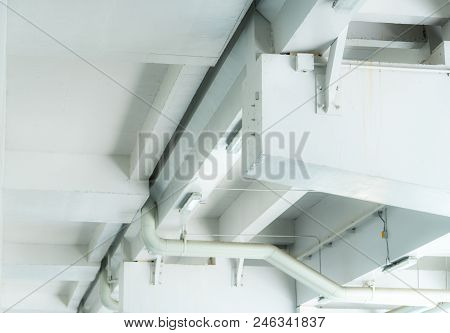 Plumbing In The Mall. Plumbing Pipe System. Building Interior Concept. Dirty White Concrete Wall