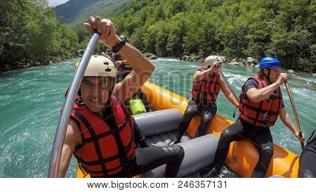 Rafting Team On White Water. Active Vacations, Team Concept. A Group Of People Enjoying White Water