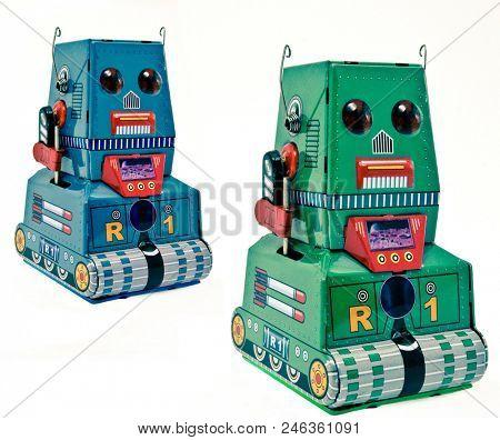two retro tin bots on white