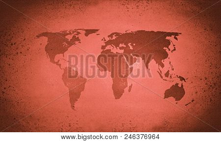 An old red faded vintage world map poster