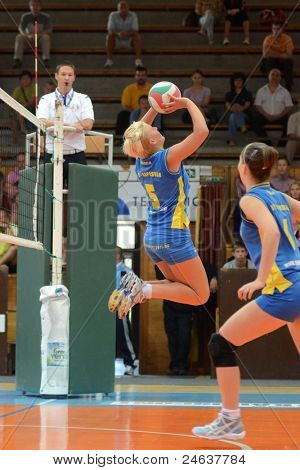 KAPOSVAR, HUNGARY - OCTOBER 2: Zsofia Horvath (5) in action at a Hungarian NB I. League volleyball game Kaposvar (yellow number) vs Tatabanya (white number), October 2, 2011 in Kaposvar, Hungary.