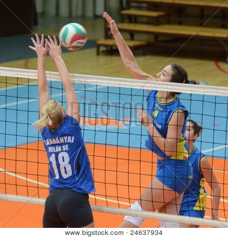 KAPOSVAR, HUNGARY - OCTOBER 2: Petra Horvath (4) in action at a Hungarian NB I. League volleyball game Kaposvar (yellow number) vs Tatabanya (white number), October 2, 2011 in Kaposvar, Hungary.