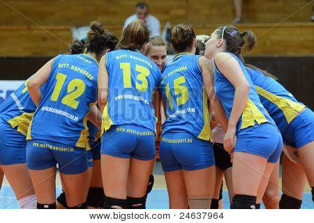 KAPOSVAR, HUNGARY - OCTOBER 2: Kaposvar players before a Hungarian NB I. League volleyball game Kaposvar (yellow number) vs Tatabanya (white number), October 2, 2011 in Kaposvar, Hungary.