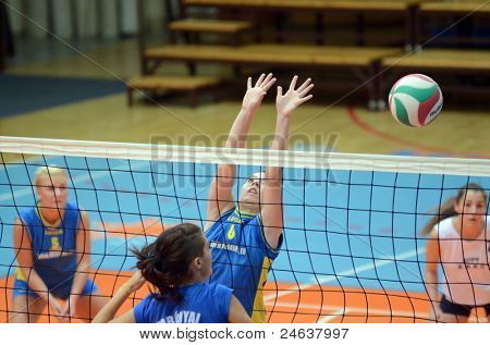 KAPOSVAR, HUNGARY - OCTOBER 2: Kamilla Gyorbiro (6) in action at a Hungarian NB I. League volleyball game Kaposvar (yellow number) vs Tatabanya (white number), October 2, 2011 in Kaposvar, Hungary.