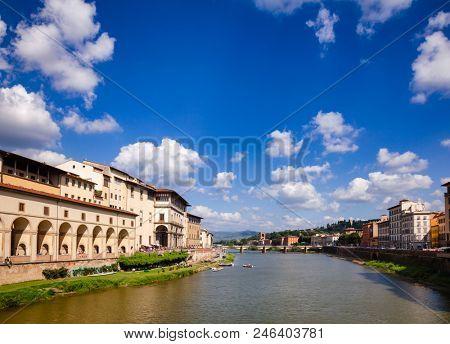 Florence cityscape with Arno River embankment, Vasari Corridor (Corridoio Vasariano) and Uffizi Gallery art museum, Ponte alle Grazie bridge and Piazzale Michelangelo square in background,  Tuscany poster